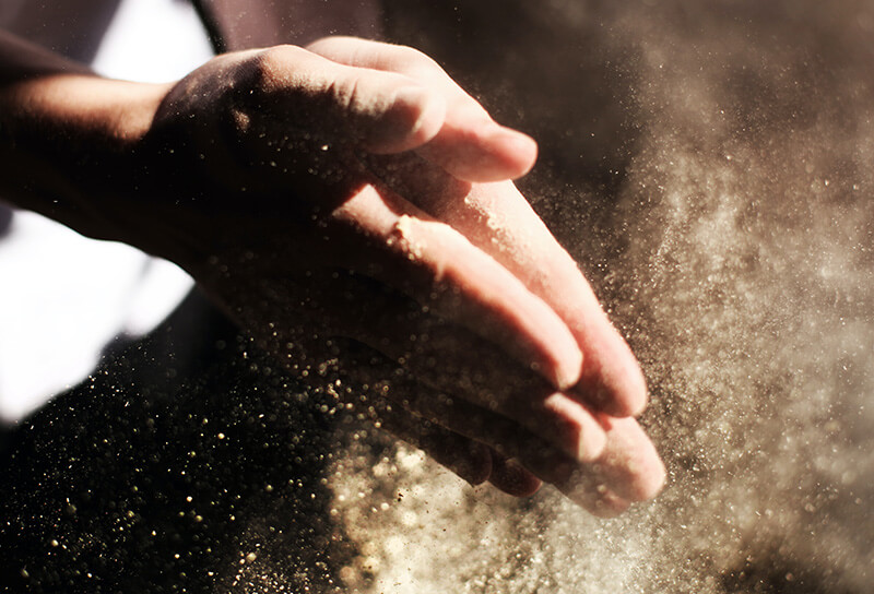 sand on man's hands