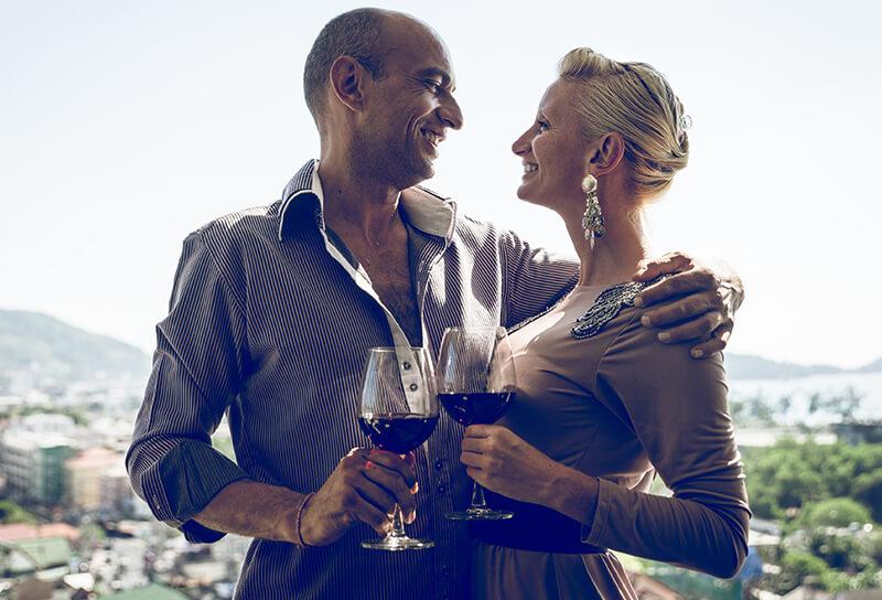 couple holding wine