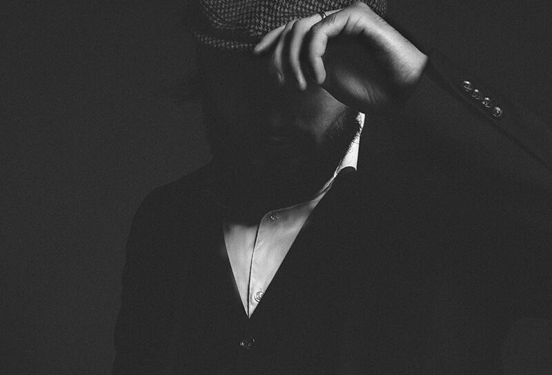 man holding his hat